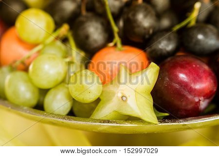 A fruit bowl with grapes in close-up