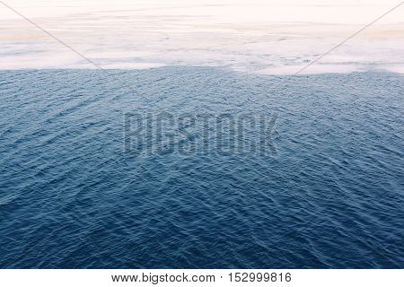 Cracked Ice Floes On A Water Frozen Ocean, Abstract Winter Background