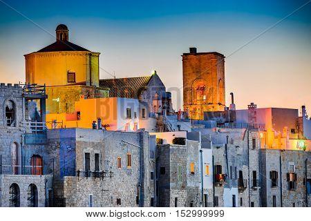 Puglia Italy. Sunset scenery of Polignano a Mare town in the province of Bari Apulia southern Italia on the Adriatic Sea