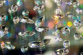 Large crystal strasses on a blur colored background. low depth of field. poster