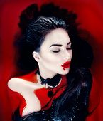 Beauty Halloween Sexy Vampire Woman with dripping blood on her mouth lying in a bath full of blood. Vampire Fashion Art design scene, glamour female vampire girl in bloody bath. Desire, thirst concept poster