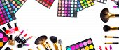 Makeup. Make-up Set Palette with colorful eyeshadows. Various cosmetics Brushes, lipgloss, lipstick, rouge, eyeshadow tints, foundation isolated on a white background. Make up artist tools Wide banner poster
