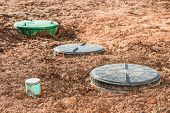 close up on three septic tanks for domestic wastewater treatment poster