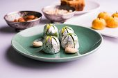Indian sweets in artistic shape and form covered with silver foil (mithai) poster