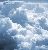 kind on clouds on a background a firmament from an airplane poster