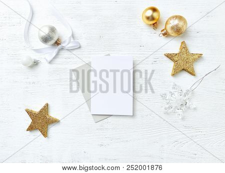 An arrangement of Christmas Decorations and blank greeting cards. Flatlay. Christmas background. Copy space
