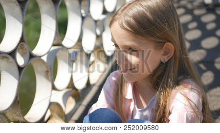 Thoughtful Child In Park, Pensive Little Girl Outdoor, Bored Expressive Kid Face