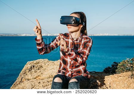 The Girl In Glasses Of A Virtual Reality. Modern Technology In Everyday Life.