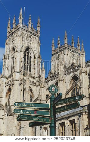 York, England - April 2018: Direction Signpost In Front Of York Minster, The Historic Cathedral Buil