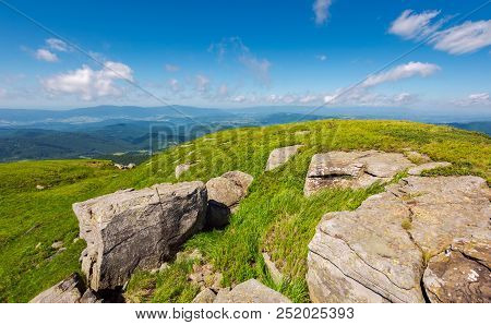 Huge Rocks On The Grassy Mountain Side. Wonderful Summer Landscape