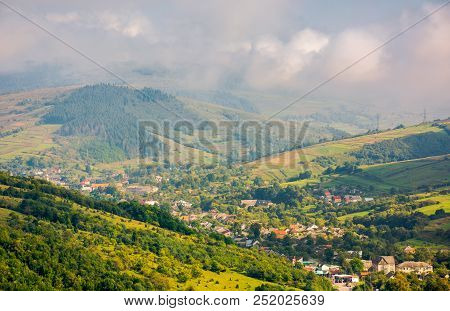 Beautiful Mountainous Countryside. Village In The Valley. Beautiful Bright Autumn Morning With Low C