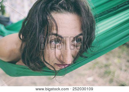 The Woman Lies In A Hammock.