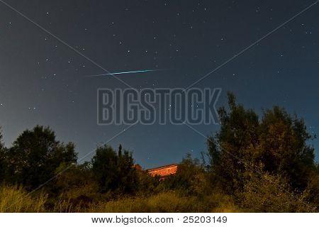 Meteor Crossing The Sky