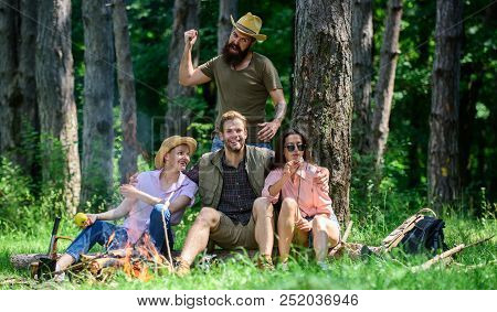 Unexpectable danger. Man brutal thief holds knife going attack hikers in forest. Company friends in dangerous situation in nature. Friends relaxing and not expect to be attacked. Be careful poster