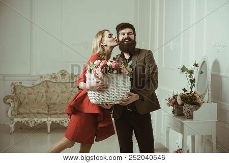 Birthday Concept. Sensual Woman Kiss Bearded Man With Birthday Flowers. Bearded Man Give Basket With