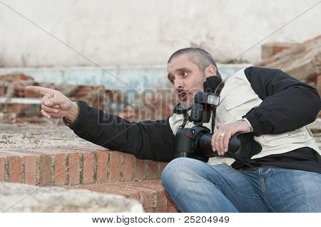 Photographer In A Dangerous Situation.