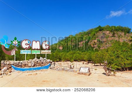 Clungup Beach, Indonesia - July 08, 2018: Clungup Mangrove Conservation Signboard. Jungle Walking Tr