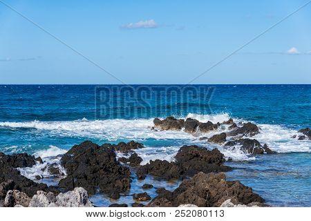 Sea Wave Crashing On Rocks Near Shore