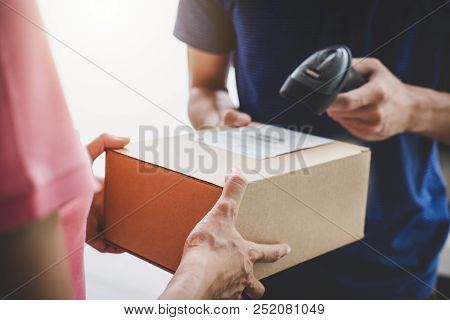 Home Delivery Service And Working Service Mind, Woman Customer Hand Receiving A Cardboard Boxes Parc