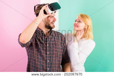 Man VR glasses involved video game while girl try to wake him up. Video game addiction symptoms and treatment. Wife tries to help him back into real life. Video game captured imagination of guy poster