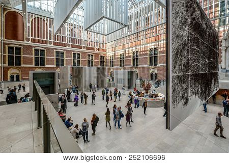 Amsterdam, Netherlands - October 2 2016: Visitors Inside The Lobby Of The Famous Art Museum, The Rij