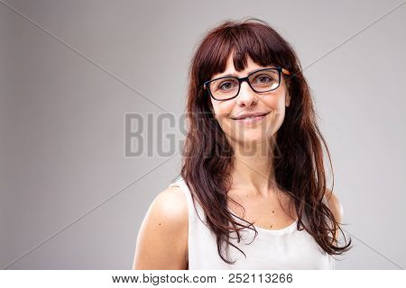 Smiling Friendly Woman Wearing Glasses