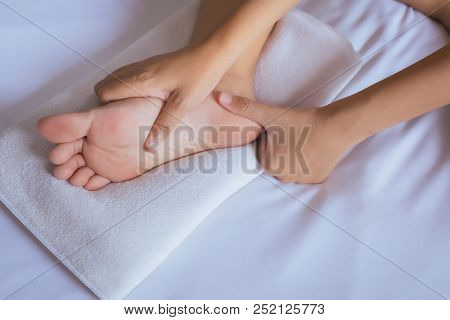 Woman Hands Giving Massage To Her Foots In Bedroom,foot Soles Massage