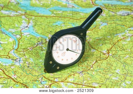 Map-Measurer On The Topographic Map.
