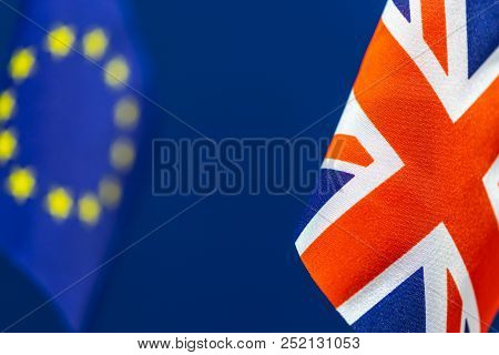 Flags Of Great Britain And Defocused United Europe With Blue Background. Brexit Concept.