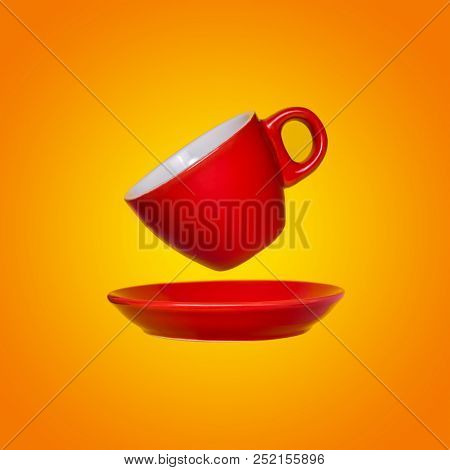 Creative Surreal Design With A Red Coffee Cup And Saucer On A Yellow Background. A Cup And Saucers F