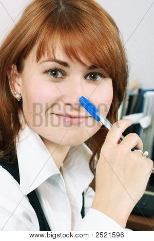 Smiling Woman With Pen