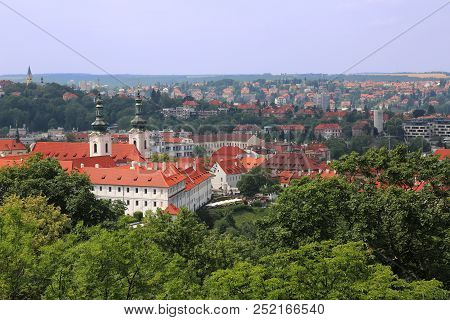 Panoramic Aerial View Of Strahov Monastery With Charming Red Roof Buildings In The Background In Pra