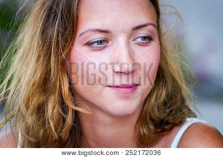 A Smiling Beautiful Blonde Caucasian Girl Close Up Portrait Stock Image. Attractive Young Woman.