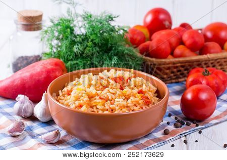 Spicy Tomato Rice On Wooden Background. Mexican Rice