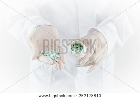 Hand Of Doctor Holding Medicine Bottle On Medicine Cabinet And Store Medicine And Pharmacy Drugstore