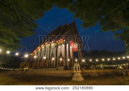 Long exposure of candle lit of buddhist in Visakha Bucha day at Temple Thailand