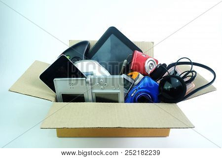 Paper Box With The Damaged Or Old Used Electronics Gadgets For Daily Use On White Background, Reuse