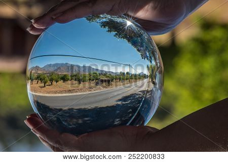 Lonely Country Road Through Rural California Seen Through Round Ball Lens With Ojai Mountains Behind