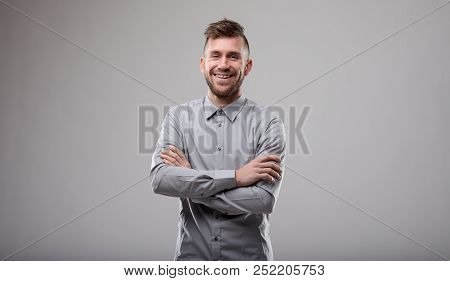 Happy Confident Man With Folded Arms