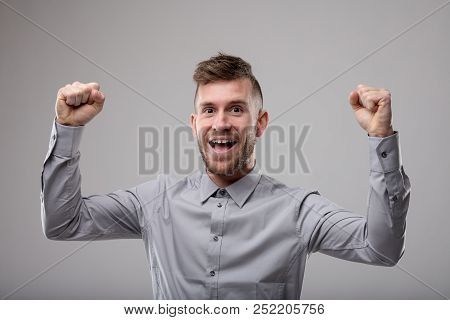 Exuberant Man Cheering And Punching The Air