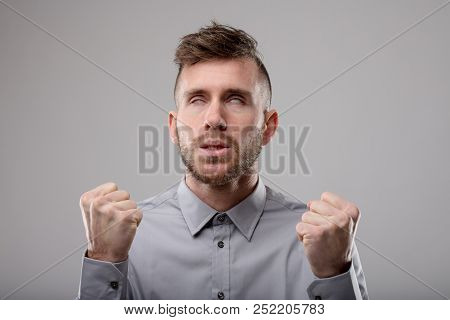 Angry Man Clenching His Fists In Frustration