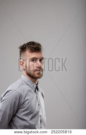 Serious Bearded Man Looking Sideways At Camera