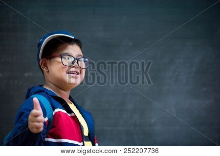 Happy Smiling Asian Boy In Glasses With Thumb Up Is Going To School For The First Time. Child With S