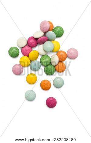Colorful candies -multicolored chocolate pills candy on white background, included clipping path