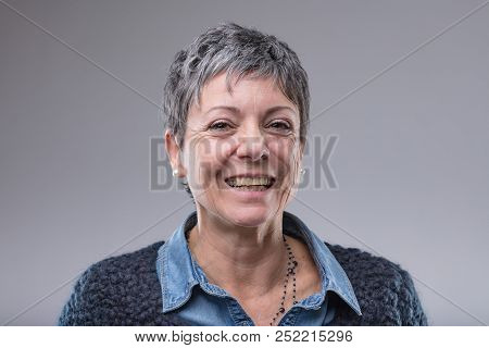 Smiling Happy Older Woman With Short Hair