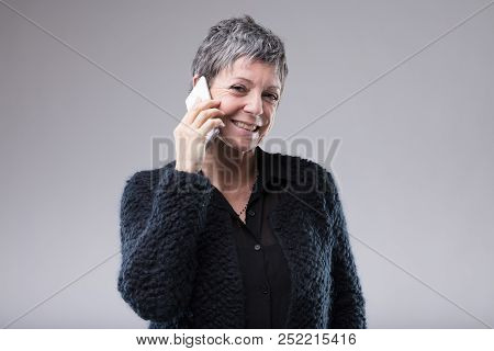 Smiling Confident Woman Chatting On Her Mobile