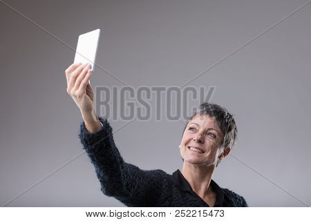 Attractive Middle-aged Woman Taking A Selfie