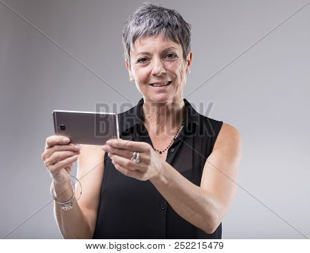 Older Woman Holding A Mobile Phone