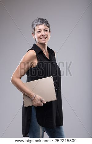 Trendy Attractive Older Woman Holding A Tablet-pc