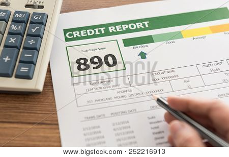 Women Checking Credit Score In Credit History Report.